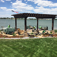 Lakeside view with pergola and outdoor kitchen